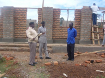 district-officer-inspecting-construction